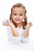 Here is my hamster - little girl with her pet Stock Photo - Royalty-Freenull, Code: 400-05919524