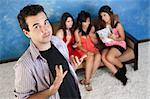 Arrogant young Caucasian man with three female admirers Stock Photo - Royalty-Free, Artist: creatista                     , Code: 400-05920981