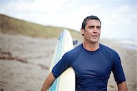 Portrait of Surfer at Beach Stock Photo - Premium Rights-Managednull, Code: 700-05947672