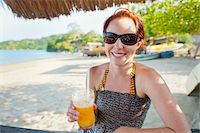 Woman with Mango Drink on Beach, near Paraty, Rio de Janeiro, Brazil Stock Photo - Premium Rights-Managednull, Code: 700-05947863