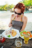 south american woman - Woman Eating Meal of Fried Fish, Rice and Beans, and Salad at Beachside Cafe, near Paraty, Rio de Janeiro, Brazil Stock Photo - Premium Rights-Managednull, Code: 700-05947867