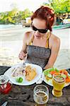 Woman Eating Meal of Fried Fish, Rice and Beans, and Salad at Beachside Cafe, near Paraty, Rio de Janeiro, Brazil Stock Photo - Premium Rights-Managed, Artist: Chris Hendrickson, Code: 700-05947867