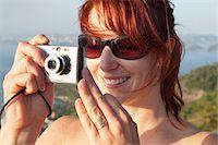 Woman Taking Photograph, Rio de Janeiro, Brazil Stock Photo - Premium Rights-Managednull, Code: 700-05947890