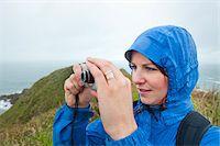 Woman Taking Photograph, Ilha do Mel, Parana, Brazil Stock Photo - Premium Rights-Managednull, Code: 700-05947891