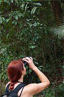 Woman Looking Through Binoculars in Forest, Rio de Janeiro, Brazil Stock Photo - Premium Rights-Managednull, Code: 700-05947899