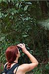 Woman Looking Through Binoculars in Forest, Rio de Janeiro, Brazil Stock Photo - Premium Rights-Managed, Artist: Chris Hendrickson, Code: 700-05947899