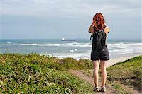 Backview of Woman Hiking and Looking at View, Ilha do Mel, Parana, Brazil Stock Photo - Premium Royalty-Freenull, Code: 600-05947901