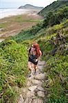 Woman Hiking up Coastal Hills, Ilha do Mel, Parana, Brazil