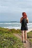 south american woman - Backview of Woman Hiking and Looking at View, Ilha do Mel, Parana, Brazil Stock Photo - Premium Royalty-Freenull, Code: 600-05947910