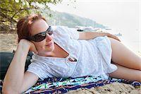 Woman Lying on Beach, Paraty, Costa Verde, Brazil Stock Photo - Premium Royalty-Freenull, Code: 600-05947924