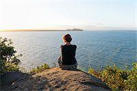 Backview of Woman Sitting on Hill, Ilha do Mel, Parana, Brazil Stock Photo - Premium Royalty-Freenull, Code: 600-05947927