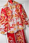 Red Wedding Outfit Hanging on Door Stock Photo - Premium Rights-Managed, Artist: Ikonica, Code: 700-05948279