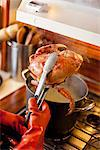 Cook Holding Dungeness Crab over Saucepan Stock Photo - Premium Rights-Managed, Artist: ableimages, Code: 822-05948340