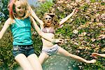 Teenage Girls Bouncing on Trampoline in front of Blooming Tree Stock Photo - Premium Rights-Managed, Artist: ableimages, Code: 822-05948375
