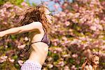 Teenage Girls Bouncing on Trampoline in front of Blooming Tree Stock Photo - Premium Rights-Managed, Artist: ableimages, Code: 822-05948376