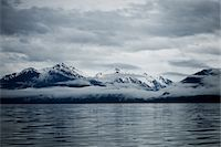 snow capped - Clouds Formation over Mountains, Admiralty Island, Alaska, USA Stock Photo - Premium Rights-Managednull, Code: 822-05948400