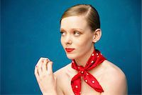 Young Woman with Red Scarf around Neck Stock Photo - Premium Rights-Managednull, Code: 822-05948433