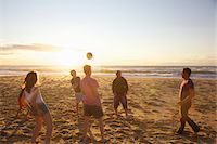families playing on the beach - Group of People Playing Volleyball on Beach Stock Photo - Premium Rights-Managednull, Code: 822-05948450