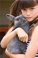 Girl Hugging Grey Rabbit Stock Photo - Premium Rights-Managednull, Code: 822-05948461