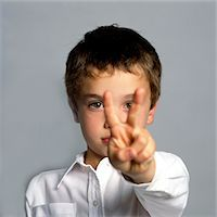 Boy Making Peace Sign Stock Photo - Premium Rights-Managednull, Code: 822-05948630