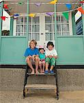 Children sitting on front steps together Stock Photo - Premium Royalty-Freenull, Code: 649-05949456