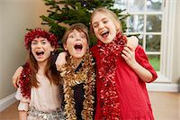 Children playing with Christmas tinsel Stock Photo - Premium Royalty-Freenull, Code: 649-05949508