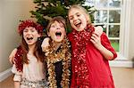 Children playing with Christmas tinsel Stock Photo - Premium Royalty-Free, Artist: CulturaRM, Code: 649-05949508
