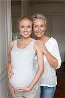Woman hugging pregnant daughter Stock Photo - Premium Royalty-Freenull, Code: 649-05949674