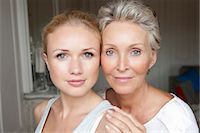 Mother and daughter smiling together Stock Photo - Premium Royalty-Freenull, Code: 649-05949675