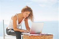 Woman using laptop outdoors Stock Photo - Premium Royalty-Freenull, Code: 649-05949752