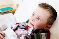 Boy with thermometer in mouth in bed Stock Photo - Premium Royalty-Freenull, Code: 649-05949800