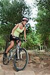 Woman mountain biking on rocks Stock Photo - Premium Royalty-Free, Artist: CulturaRM, Code: 649-05949859