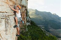 Climber scaling steep rock face Stock Photo - Premium Royalty-Freenull, Code: 649-05949889