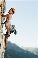 rock climber - Climber scaling steep rock face Stock Photo - Premium Royalty-Freenull, Code: 649-05949892
