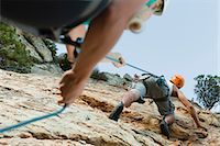 Climbers scaling steep rock face Stock Photo - Premium Royalty-Freenull, Code: 649-05949893