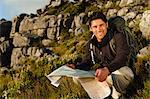 Hiker reading map in rocky field Stock Photo - Premium Royalty-Free, Artist: Bettina Salomon, Code: 649-05949897