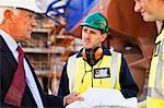 Workers reading blueprints on dry dock Stock Photo - Premium Royalty-Freenull, Code: 649-05950060