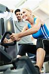 Woman working with trainer in gym Stock Photo - Premium Royalty-Free, Artist: CulturaRM, Code: 649-05950153