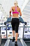 Woman using exercise machine in gym Stock Photo - Premium Royalty-Freenull, Code: 649-05950168