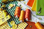 Thread, buttons, measuring tape on desk Stock Photo - Premium Royalty-Freenull, Code: 649-05950270