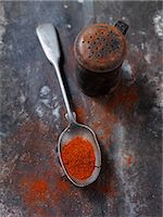 paprika - Spoonful of paprika spice on countertop Stock Photo - Premium Royalty-Freenull, Code: 649-05950415