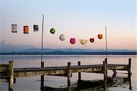 Paper lanterns strung up on wooden pier Stock Photo - Premium Royalty-Freenull, Code: 649-05950533
