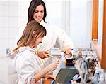 Mother and daughter brushing teeth Stock Photo - Premium Royalty-Freenull, Code: 649-05950587
