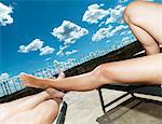 Couples bare legs on lawn chairs Stock Photo - Premium Royalty-Free, Artist: Blend Images, Code: 649-05950633