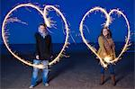 Couple playing with sparklers on beach Stock Photo - Premium Royalty-Freenull, Code: 649-05950697