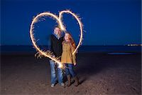Couple playing with sparklers on beach Stock Photo - Premium Royalty-Freenull, Code: 649-05950698