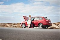 remote car - Woman with broken down car on rural road Stock Photo - Premium Royalty-Freenull, Code: 649-05950788