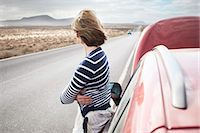 remote car - Woman with broken down car on rural road Stock Photo - Premium Royalty-Freenull, Code: 649-05950789