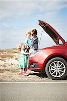 Family sitting by broken down car Stock Photo - Premium Royalty-Freenull, Code: 649-05950801