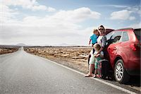 Family standing by broken down car Stock Photo - Premium Royalty-Freenull, Code: 649-05950802